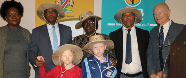Local bank supports albinism sufferers, donates 250 sun protection hats