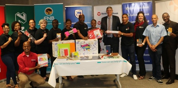 Bankers bury the hatchet to collect large amounts of stationery for schools to use in the new year