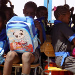 Monte Christo Project Primary School learners get backpacks to start off the new term