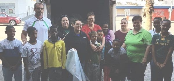 Volunteer group collects food and basics, then distribute to destitute households
