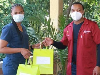 Underprivileged first-year nursing students receive workplace attires from local company