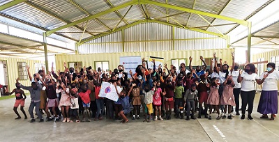 Orphaned and vulnerable children impacted by AIDS and poverty receive a helping hand